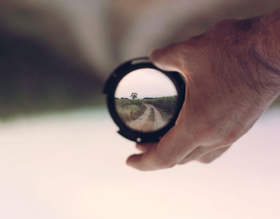 Person Holding Lens Focus