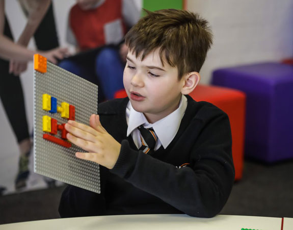 Child playing with Lego's new braille bricks