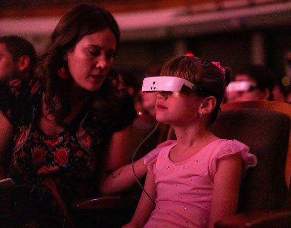Little girl enjoys a concert using her eSight
