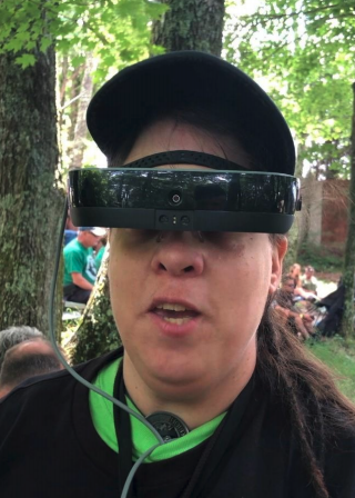 Bambie Parsons is seen wearing her eSight glasses for the visually impaired at a rock concert