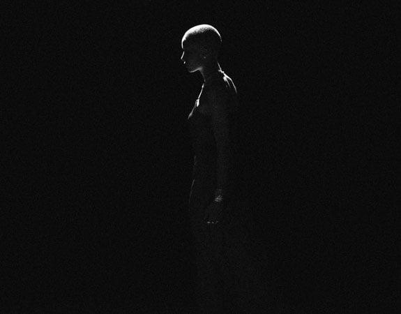 Shape of a women in a dark room.