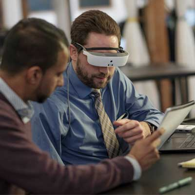 Many uses eSight's low vision device in the workplace