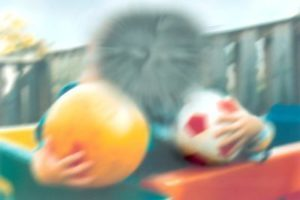 What someone with macular degeneration might see - blurred central vision, unable to make out a face.