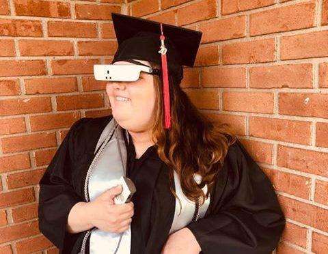 Drue Collins wearing eSight at graduation