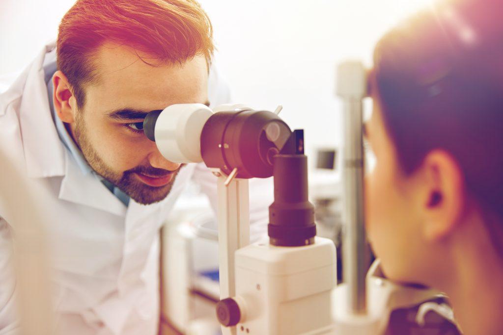 Optician performing tonometry test.